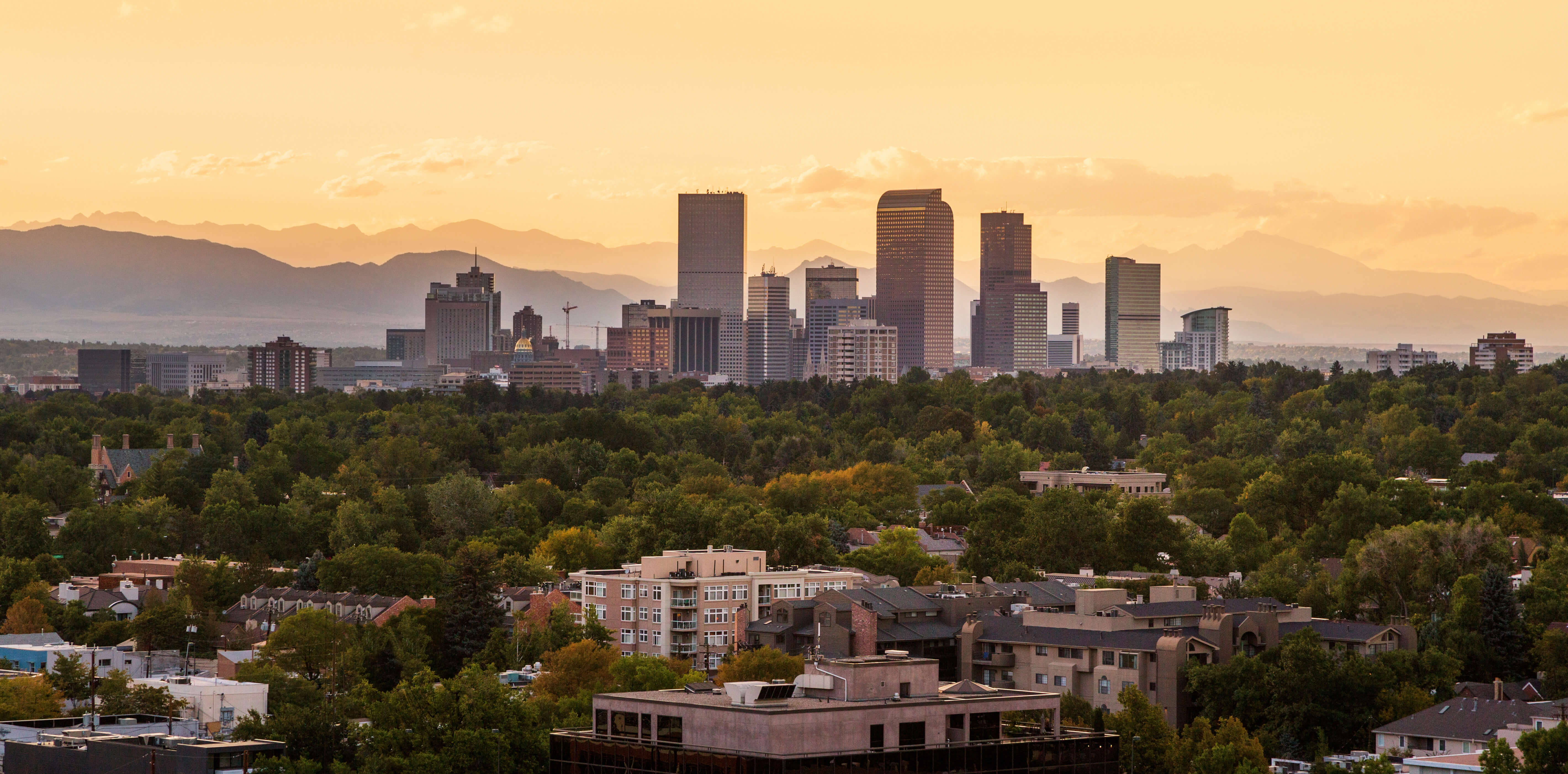 Downtown Denver with the Colorado Rockies behind