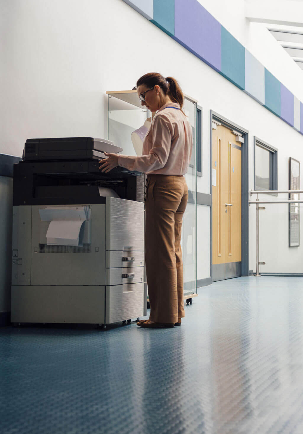 Woman printing from office printer