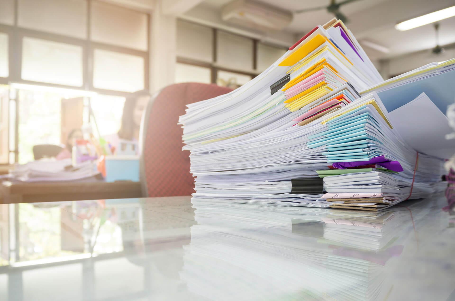 paper-stack-on-desk